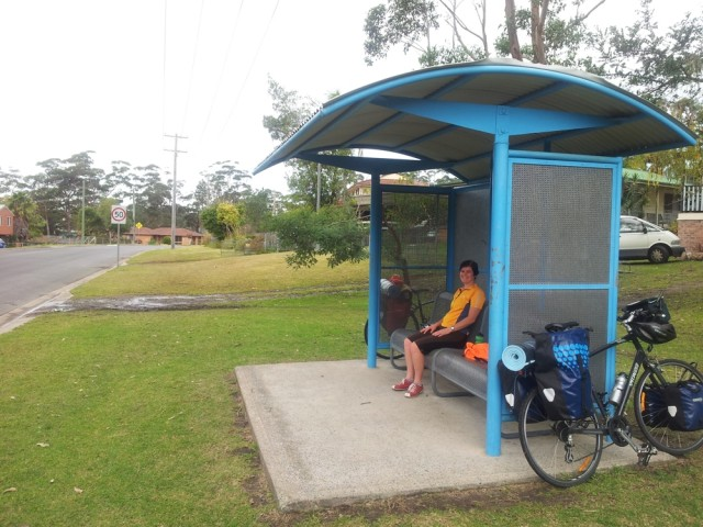Lunching in a bus shelter