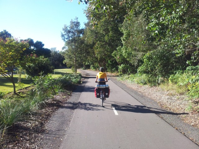 Jen on the Fernleigh Track.  Looks like a mini road only for cyclists and pedestrians.